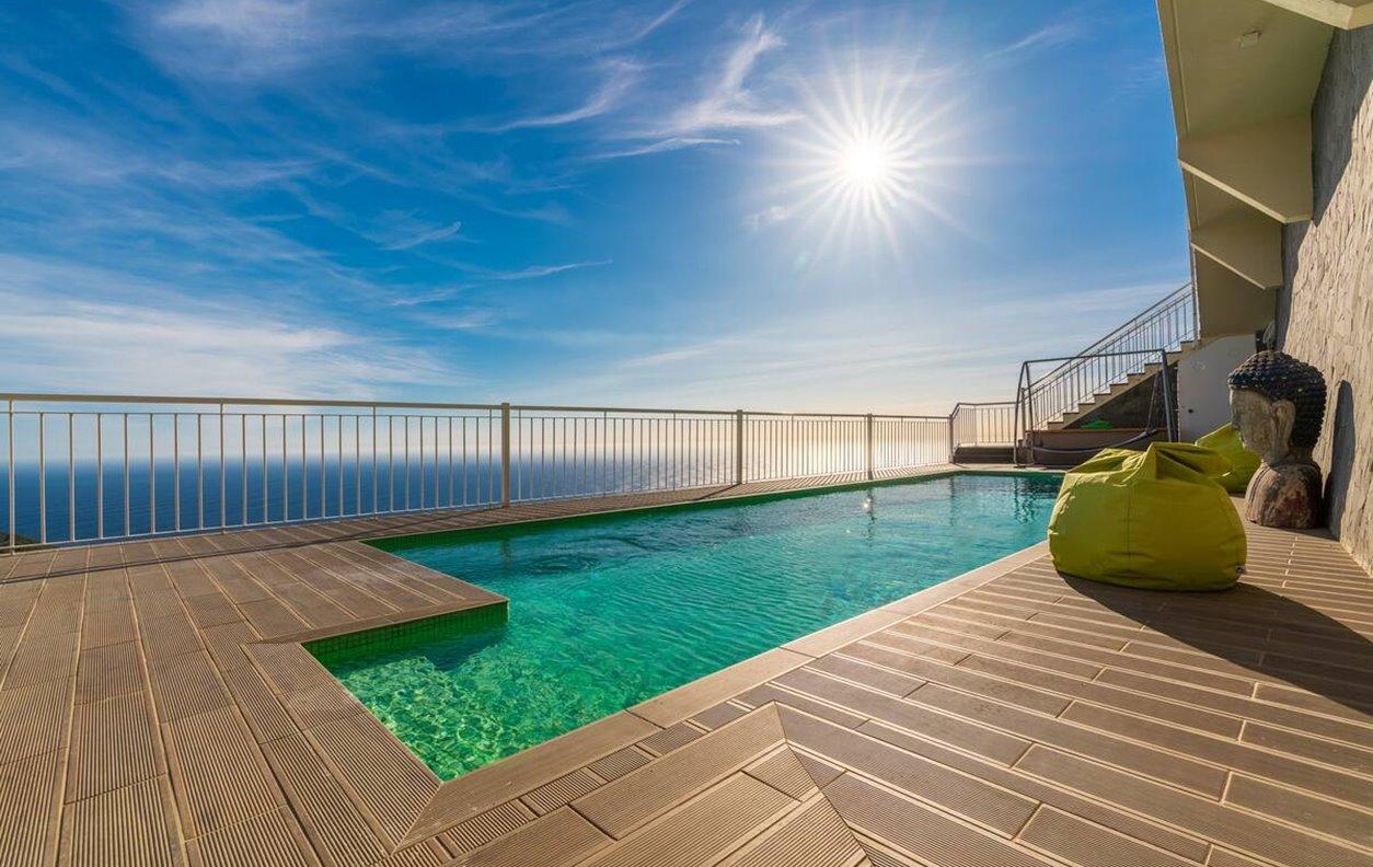 Casa de Fériascom Piscina Aquecível e Jardim,Vista Mar, A/C, BBQ e Wi-Fi - Próximo Praia da Calheta - 12965